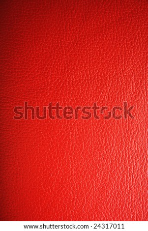 A red leather texture with gradient look. - stock photo