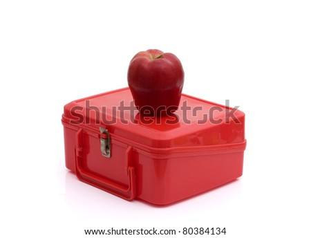 A red lunchbox with an apple isolated on white, Healthy School Lunch - stock photo