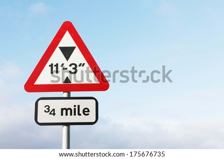 A red maximum height traffic sign  against a partly cloudy sky background with copy space.