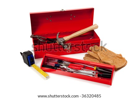 A red metal toolbox with assorted tools on a white background with copy space, Handy man theme - stock photo