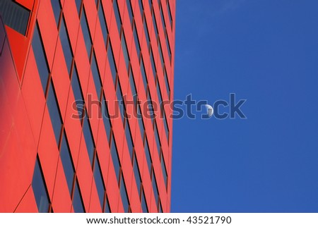 A red modern office building and the moon in the blue sky, edmonton downtown, alberta, canada - stock photo