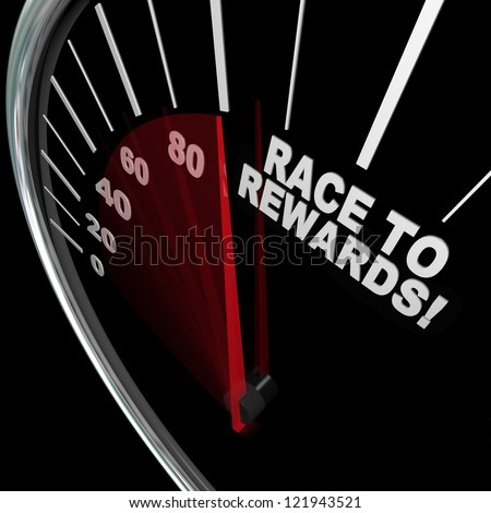 A red needle racing on a speedometer to the words Race to Rewards to illustrate the accumulation of customer loyalty points in a reward program for buyers - stock photo