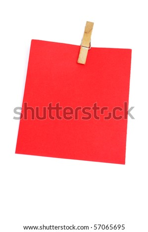 a red notebook leaf with a clothespin isolated on a white background
