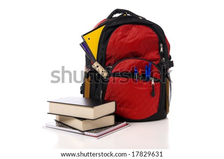 A red overflowing school backpack  or book bag with school books on a white background - stock photo