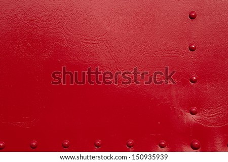 A red painted metal background. - stock photo