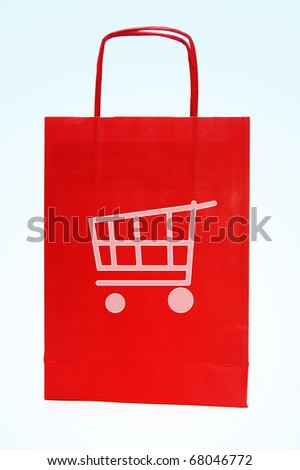 a red paper bag with a drawing of a shopping cart - stock photo