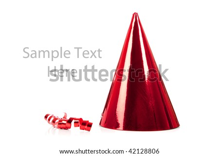 a red party hat and streamer on a white background with copy space - stock photo
