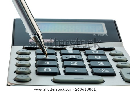 a red pen is on a calculator. save on costs, expenses and budget for bad economy - stock photo