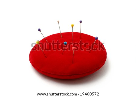 a red pin cushion isolated on white background