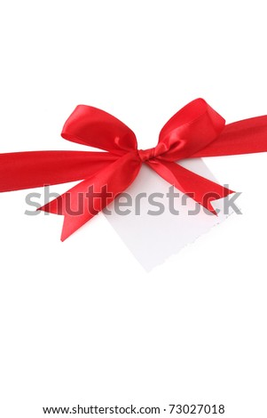 a red ribbon with a bow on white - stock photo