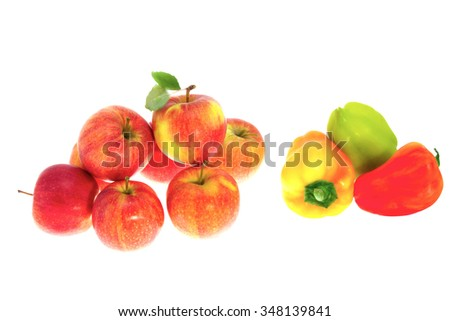 a Red ripe apples and sweet pepper on a white background
