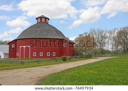 A red round barn in a horizontal format