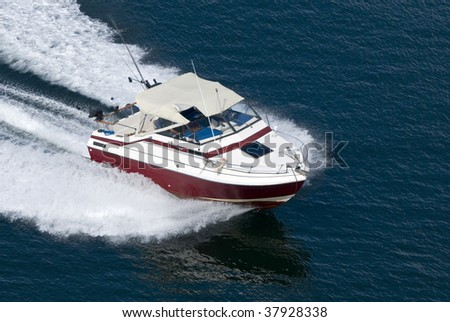 A red runabout shot from above while travelling fast. - stock photo