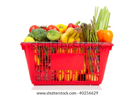 A red shopping baskets with vegetables including bananas, celery, peppers, bell peppers, celery, broccoli, squash, zucchini, asparagus and tomatoes on a white background