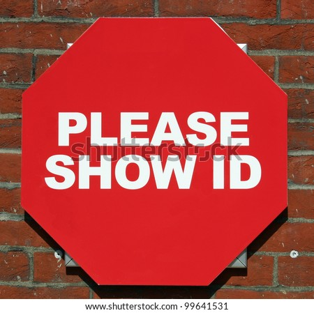 A red sign reading Please Show ID - stock photo