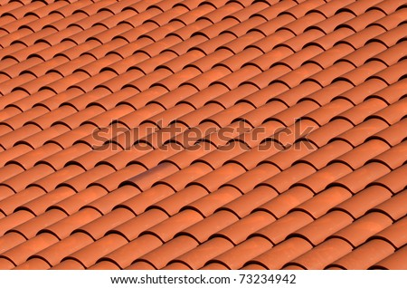 a red tiled terracotta roof - stock photo