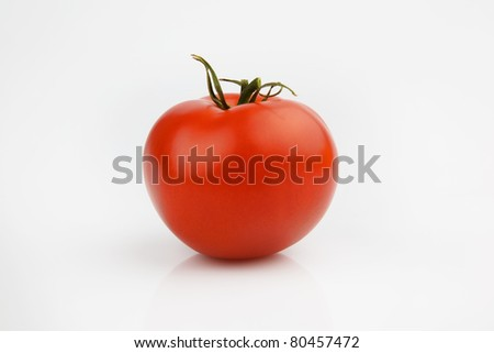a red tomate on a white background - stock photo