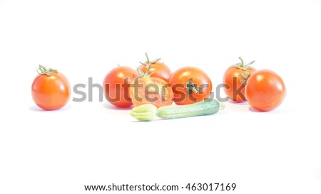 A red tomatoes and zucchini isolated on white background