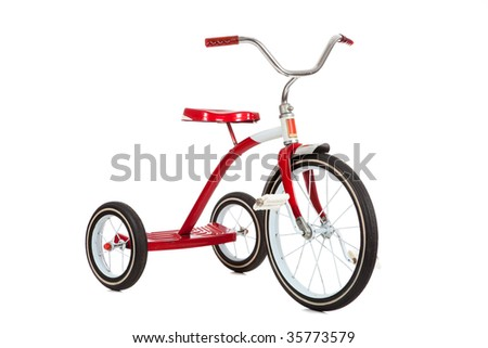 A red toy tricycle on a white background with copy space - stock photo