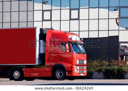 a red truck at warehouse - stock photo