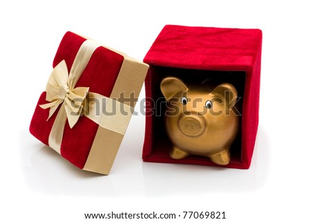 A red velvet present opened with piggy bank and gold bow isolated on white, Happy Holidays - stock photo