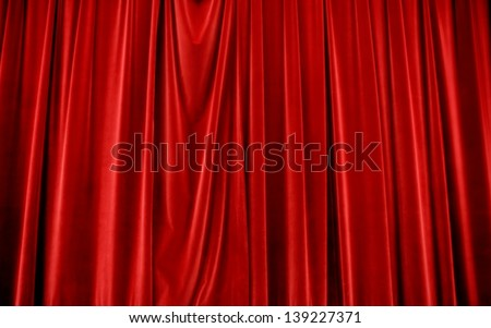 A red velvet stage curtain makes a luxurious background - stock photo