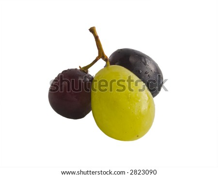A red, white and black grape all on the same vine