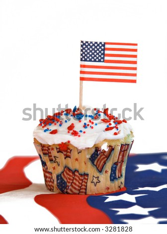 A red, white and blue  American flag holiday celebration cupcake.