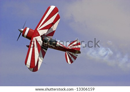 a red-white  biplane at an air show. - stock photo