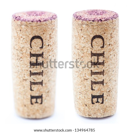 A red wine stained wine cork with 'Chile' written on it, isolated on white background, in vertical position with the writing pointing downwards. Two types of depth of field - shallow and deep. - stock photo