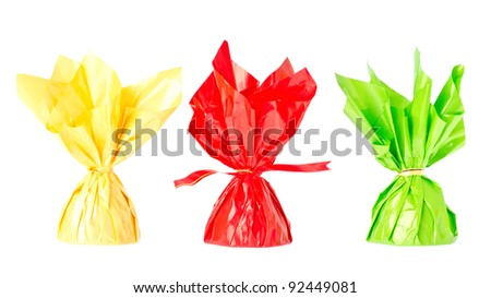 a red, yellow and green candy, isolated on white