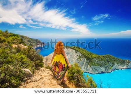 A redhead enjoying the view at Navagio beach, Zakynthos island, Greece - stock photo