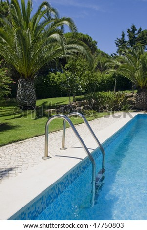 a refresh water pool and a healthy garden at a Beautiful villa (Algarve, south of Portugal) - stock photo