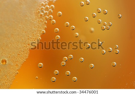 A refreshing lager with detail on the bubbles. - stock photo