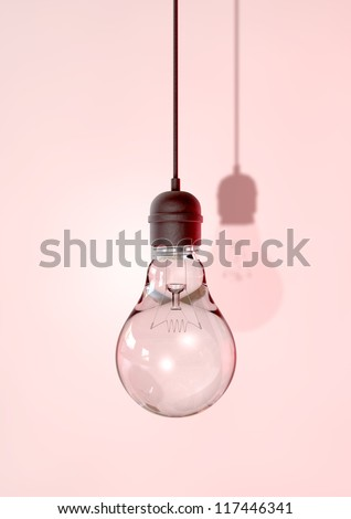 A regular unlit light bulb fitted into a light fitting hanging from a chord on an isolated background - stock photo