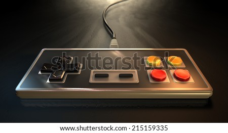 A regular vintage rectangular gaming controller with red and yellow buttons on an isolated dark spotlit studio background - stock photo