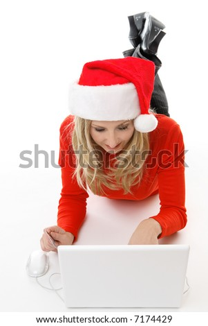 A relaxed female using a laptop, browsing and shopping online for gifts - stock photo