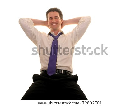 A relaxed, stress free businessman leans back comfortably in his chair. - stock photo