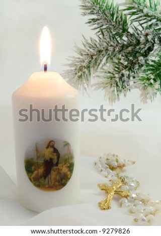a religious candle with Christian cross and Christmas pine - stock photo