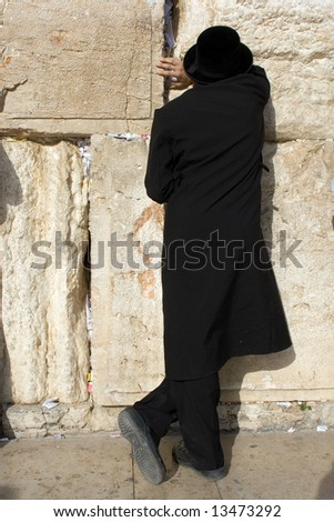 A religious orthodox Jew prays at the Wailing Wall. Jerusalem, Israel. - stock photo