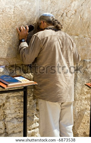 A religious orthodox Jew prays at the Wailing Wall. Jerusalem, Israel.