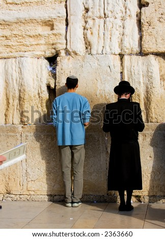 A religious orthodox Jews pray at the western wall. Jerusalem, Israel. - stock photo
