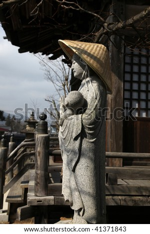 A religious statue outside a traditional Japanese Temple in Takayama Japan