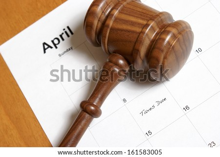 A reminder for American tax payers is set on the calendar. - stock photo
