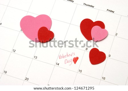A reminder on a calendar for couples to celebrate. - stock photo