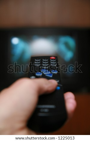 a remote control pointing to a tv - stock photo