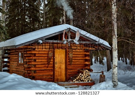Remote log cabin during winter alaskas stock photo for Cabina remota alaska