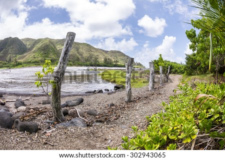 A remote trail along the east end of Molokai Island leads to a beautiful beach facing a very untraveled part of Hawaii - stock photo