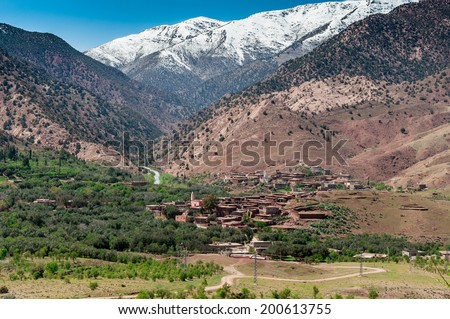 A remote village located in a deep vallet high in the Atlas Mountains, Morocco. - stock photo