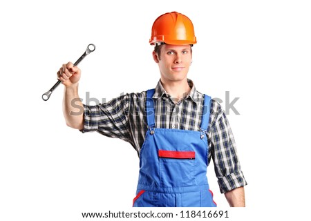 A repairman in overall holding a toolbox and wrench isolated on white background - stock photo